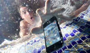 Man drops his phone to pool